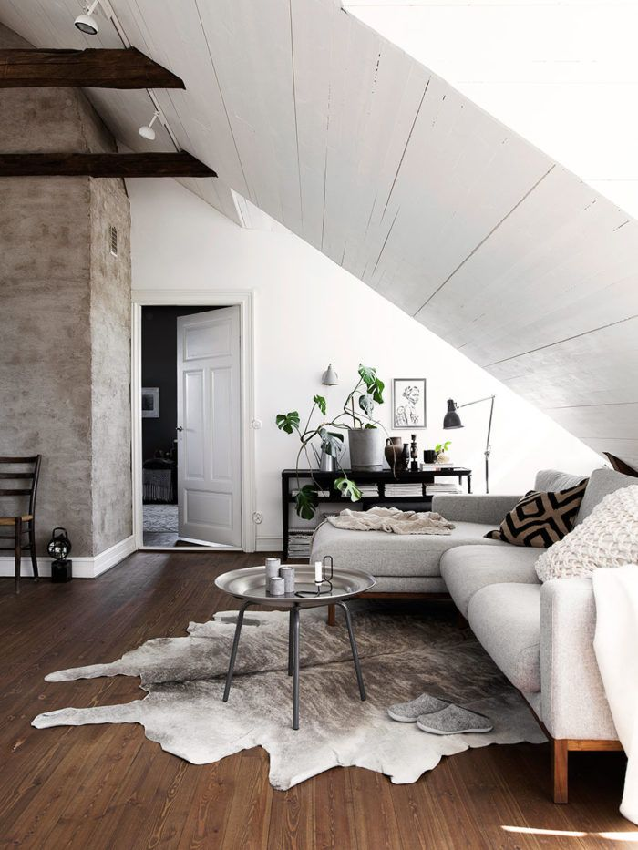 cow hide rug in a white scandinavian home