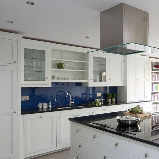 Blue And White Kitchen loving the blue glass backsplash in this classic white #kitchen