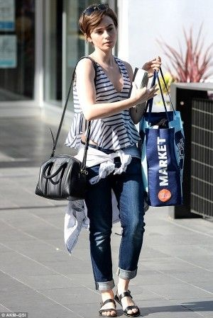 Lily Collins wearing Givenchy Black Leather Mini Duffle Bag and Elizabeth and James Chester Striped Poplin Top