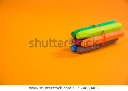 Crayons Colors Tight In A Rubber Band On Vibrant Orange Background Stock Photos Orange Background Rubber Bands