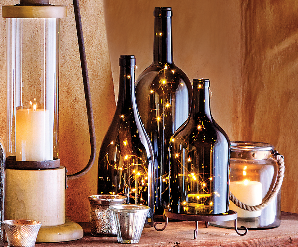 Italian wine bottle hurricanes stands with copper wire for Wine bottle patio lights