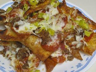 Copycat recipe of Old Chicago Italian Nachos: banana peppers, pepperoni, italian sausage, pepper jack and mozzarella cheese