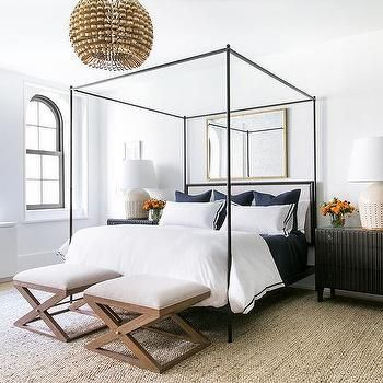 Gold Rectangular Mirror Over Black Canopy Bed Where The