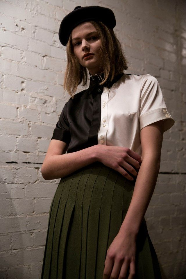 Scottish heritage with a subcultural twist. Black and white silk button down blouse with a pleated green skirt Le Kilt AW16
