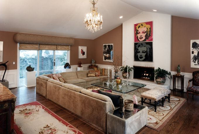 Andy Warhol's classic Marilyn Monroe paintings inject fun in this elegant living room.  The client's Lalique crystal collection adorns the large glass coffee table. This is an Eclectic interior at it's best. Tamara Kessler & Assoc Inc