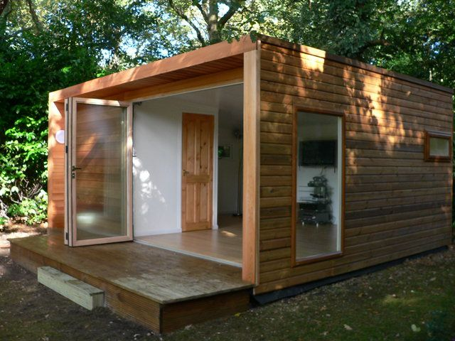 Cedar cladding and bifold doors just like the enterprise for Cedar garden office