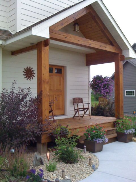 Rustic porches new timber frame accents from old wood for Timber frame porch designs