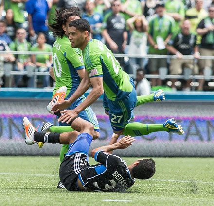 Lamar Neagle launches himself -- and his first of two goals -- over San Jose's Steven Beitashour. Photo by Dean Rutz / The Seattle Times