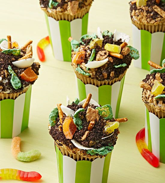 """Kids will really """"dig"""" our Compost #Cupcakes, complete with Oreo """"dirt,"""" pretzel sticks, and gummy worms."""