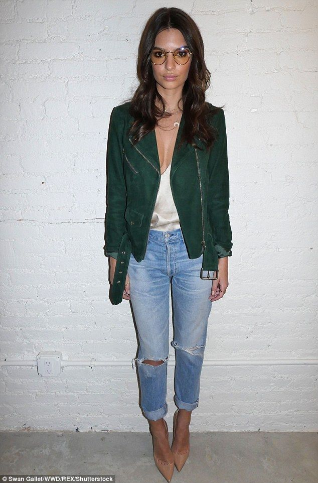 Emily Ratajkowski flashes a hint of her famous cleavage in ...