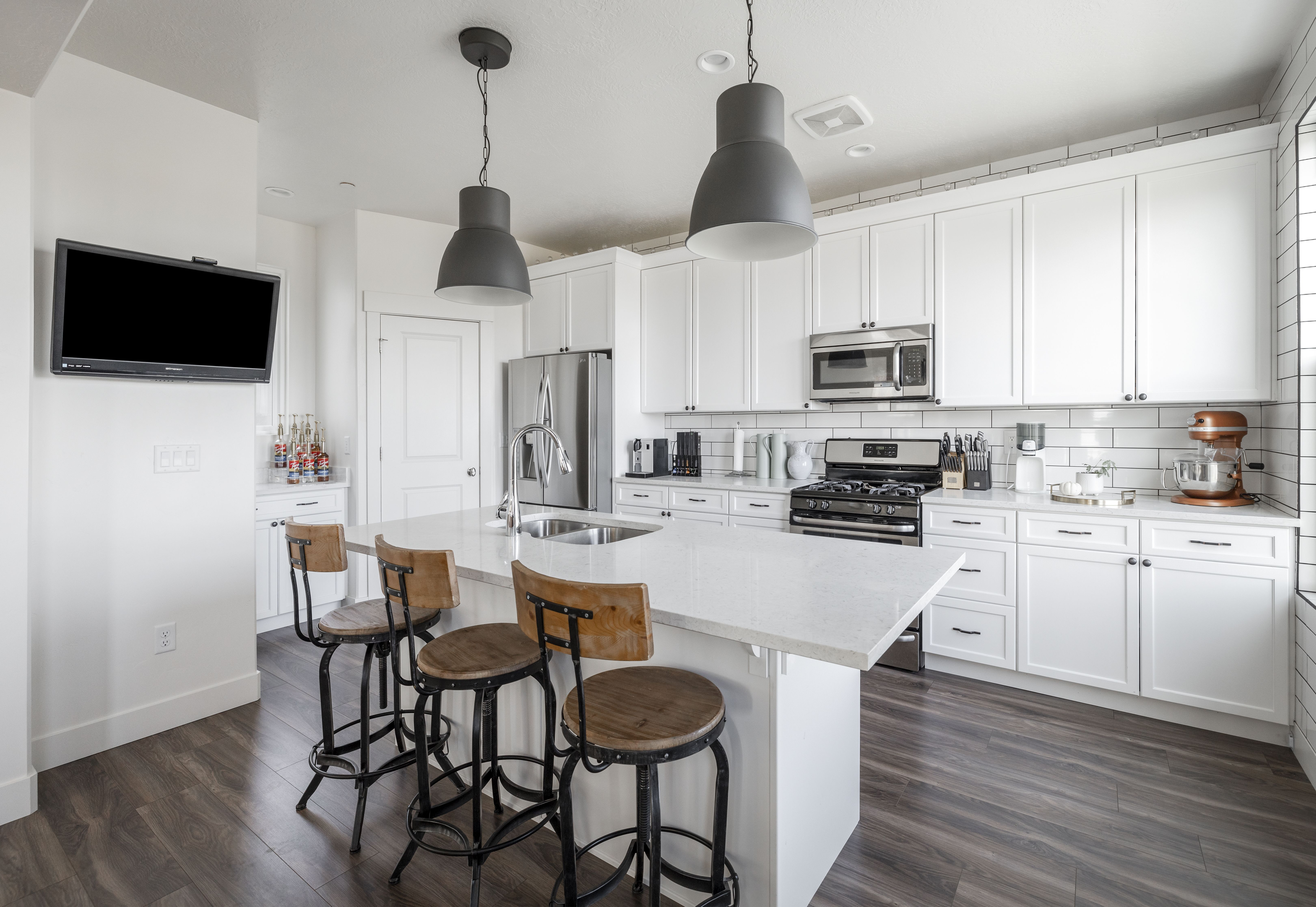 On the 1st level you will find the beautiful modern kitchen, that is brilliantly designed with quartz countertops, stainless-steel appliances, tile backsplash and wall. #Kitchen #KitchenDesign #KitchenDecor #HomeDecor #HomeDesign #DiningRoomDecor #Minimal #Bohemian #LightingDesign #Modern #WindermereUtah #RealEstate #HomesForSale #UtahHomes #DreamKitchen #KitchenGoals #Modern #ModernIndustrial