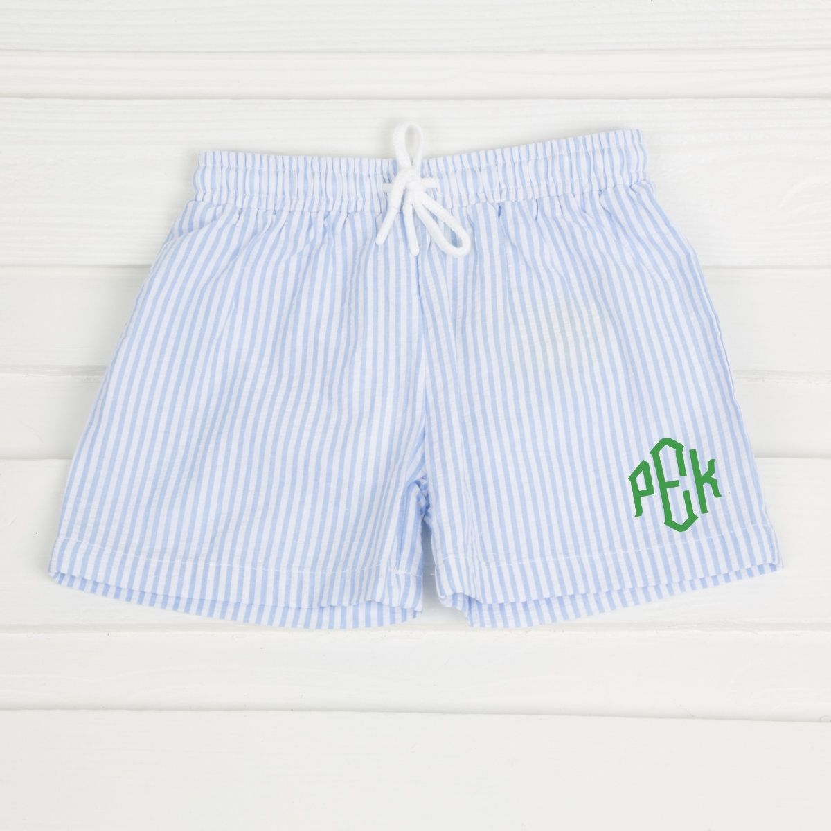44545f9ee8 This adorable swim trunk is a must this season! Light blue seersucker  stripe fabric. Cotton blend seersucker. *NOT LYCRA* Mesh lined. Tie waist  band.