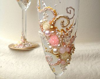 Beautiful wedding champagne glasses in blush pink, gold and ivory, elegant toasting flutes with pearls and roses