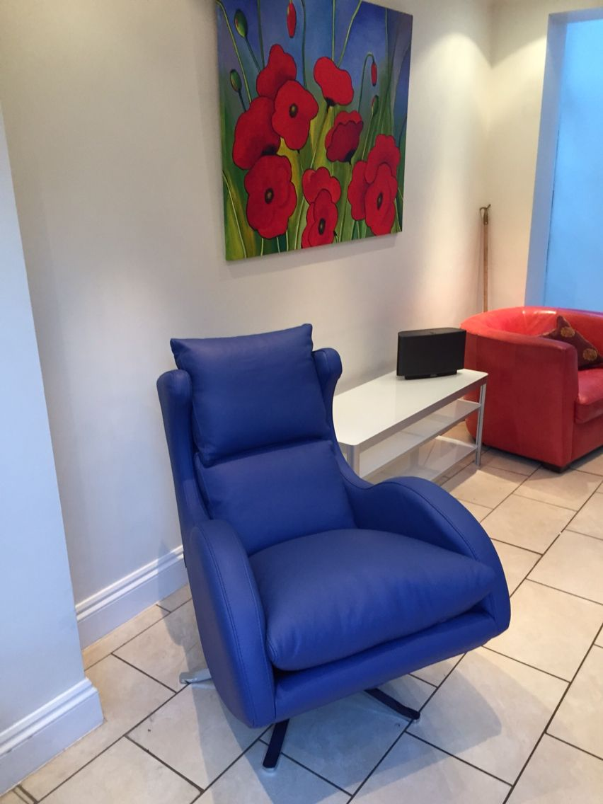 Bright blue leather on our swivel chair leather swivel