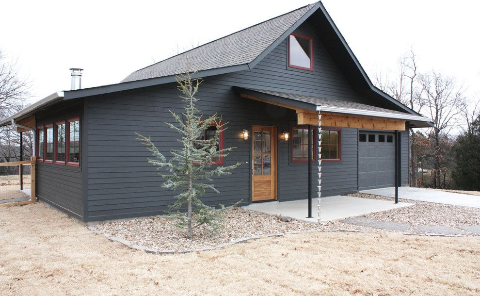 Metal building homes exterior farmhouse with cottage dark for Steel pole house designs