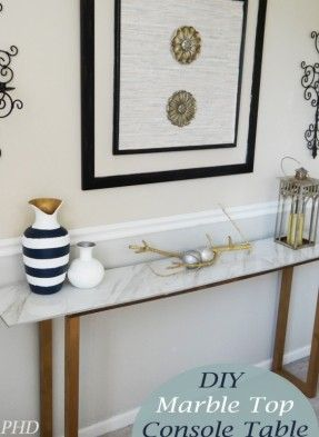 DIY Marble Top Console Table - Marble tiles are far less expensive and lighter weight than a slab, and you don't have to have them cut and polished. Glue them to any plain table to spice it up. May wish to surround them with molding for an inlaid look tha