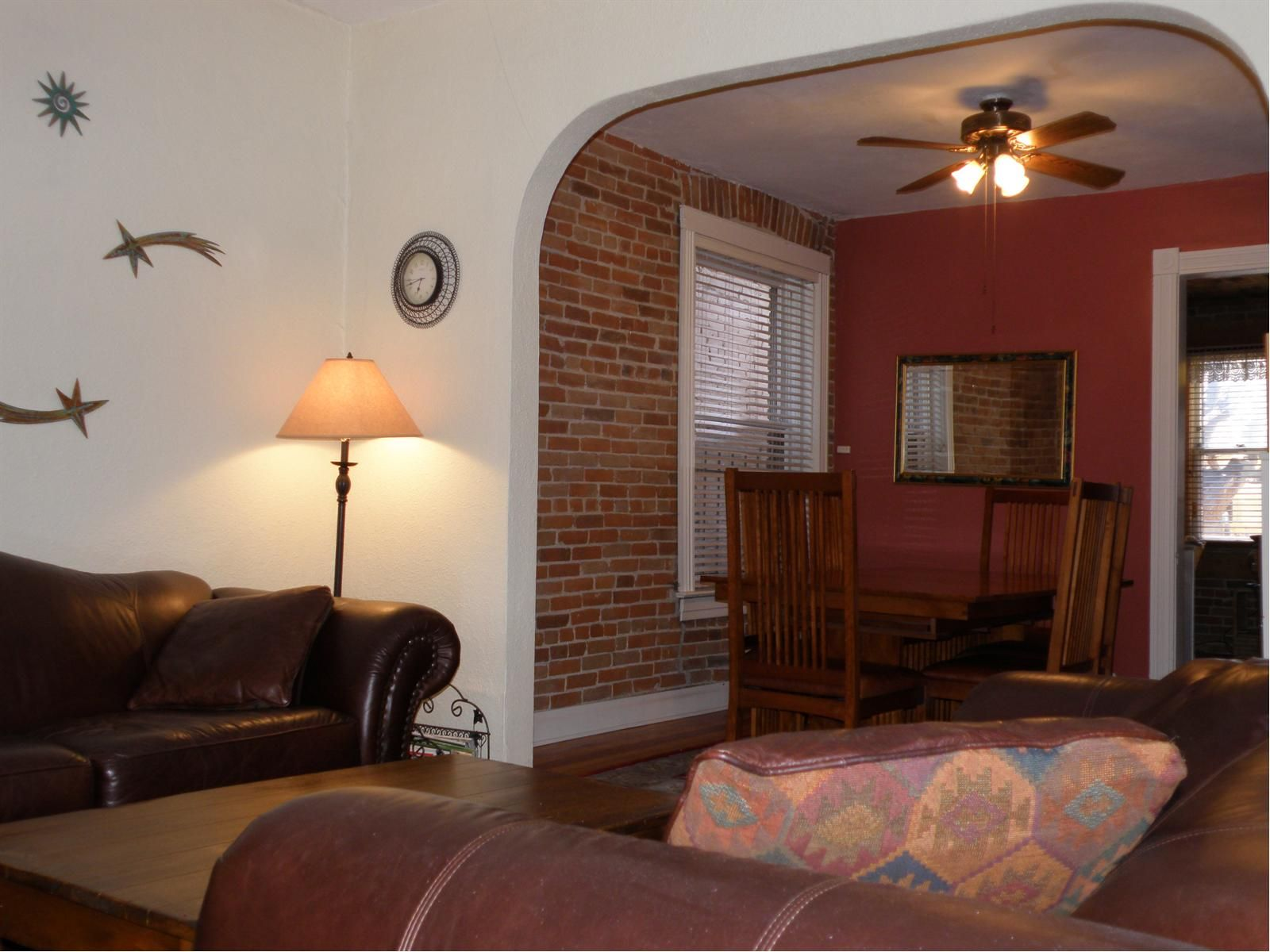 Living Room Has Direct Access To Dining Exposed Brick Ceiling Fan And Crown