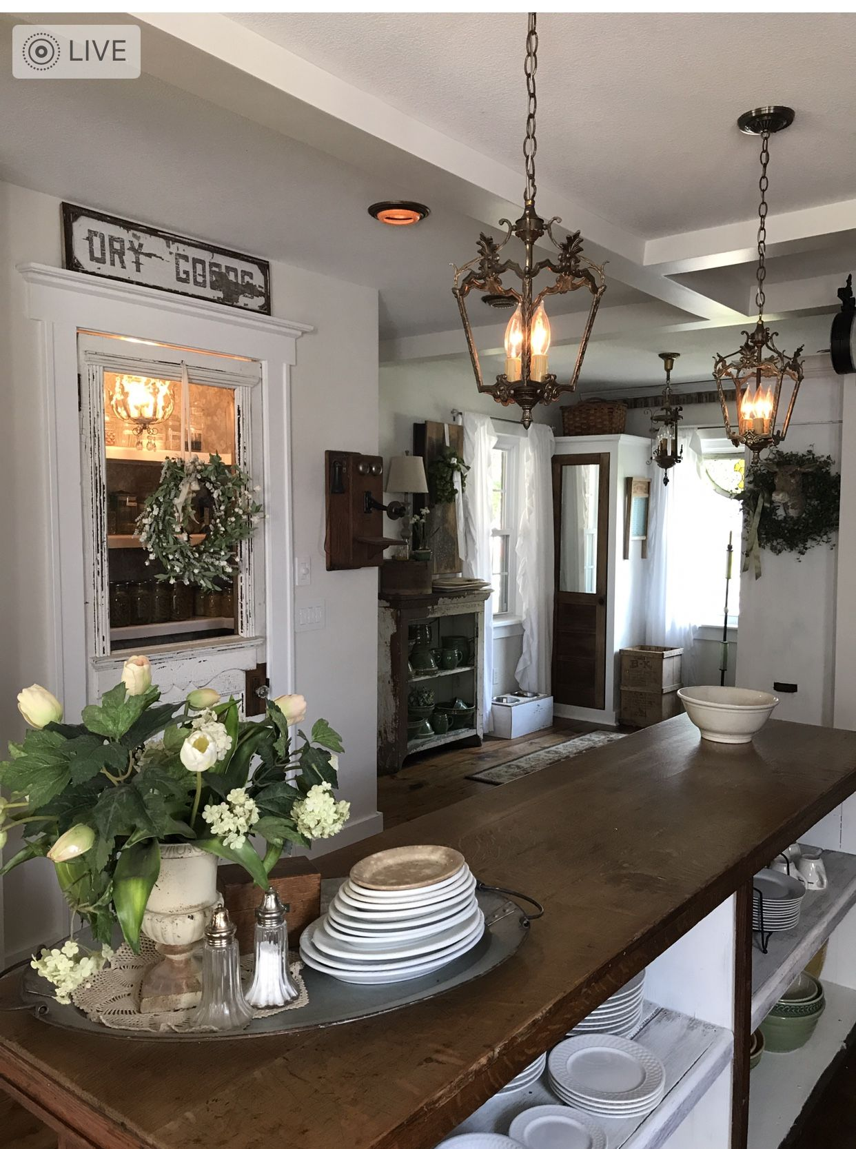 White chippy pantry door with antique store counter as an island