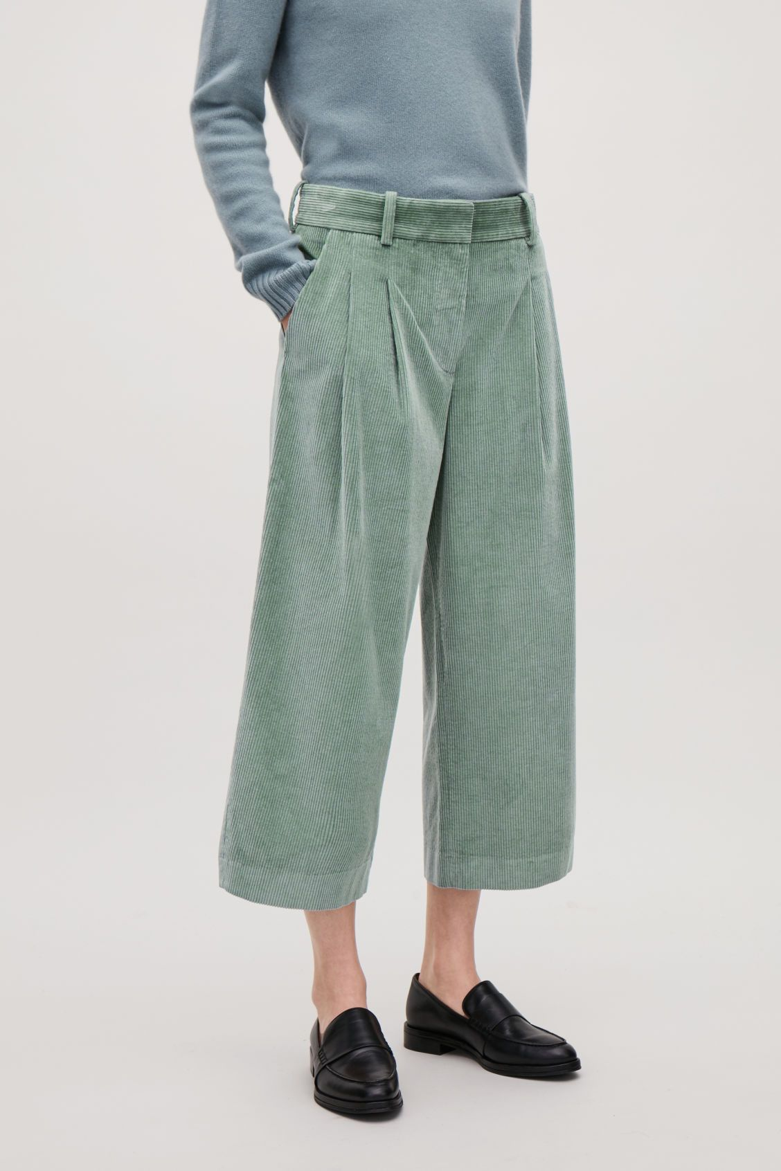 ee04fa7da39e Model side image of Cos wide-leg corduroy trousers in green ...