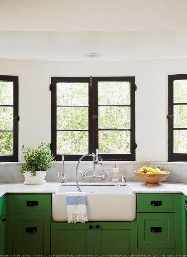 green kitchen black window trim, white walls