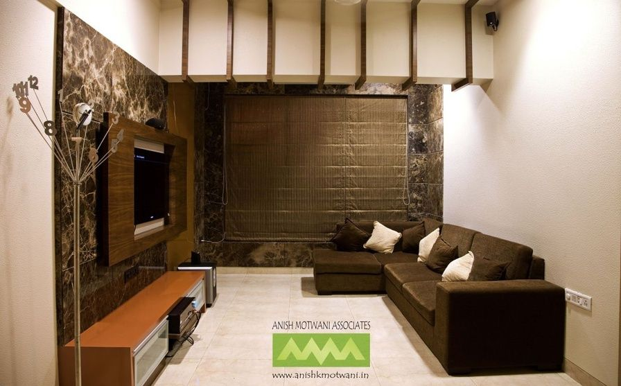 large living room with brown sofas design by anish
