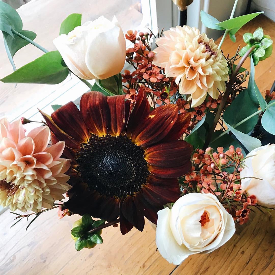 Seasonal flower bouquet with sunflowers, dahlias, roses