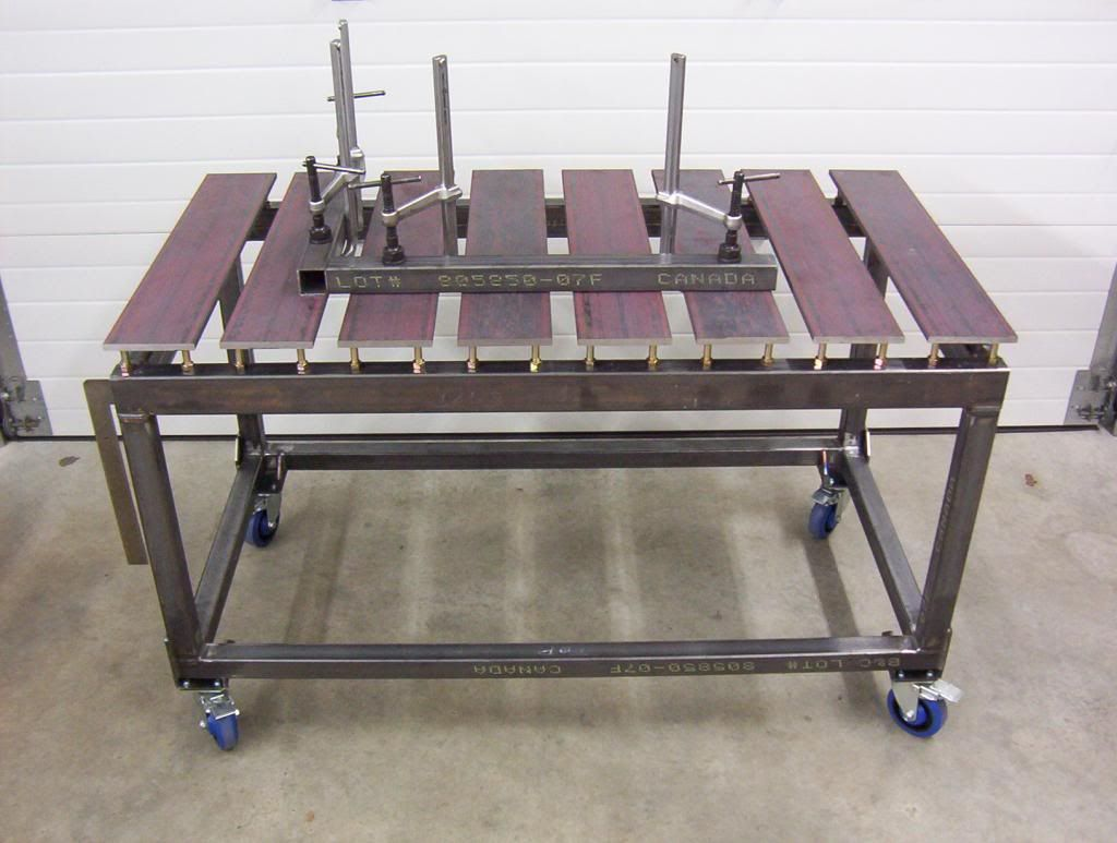 Welding Table Designs welding table with steel 2x3 rectangular tubing with round tubes through the ends as the Metal Welding Table