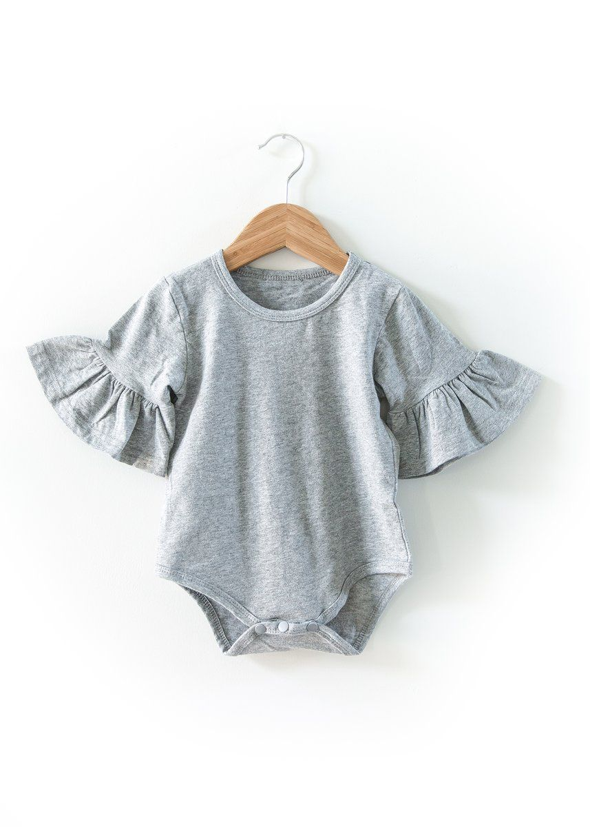 98e1222a5d5 Simple yet adorable. The bell sleeves add the perfect amount of cuteness to  this onesie. Can be worn alone or under many of our strap outfits.