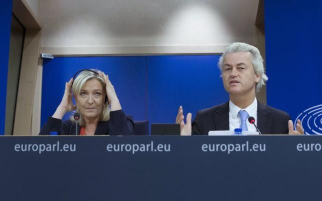 France's National Front political party head Marine Le Pen, and Netherlands' far-right Party for Freedom (PVV) leader Geert Wilders hold a joint news conference at the European Parliament in Brussels. (Both have studied law. And no, that is not just a coincidence.)