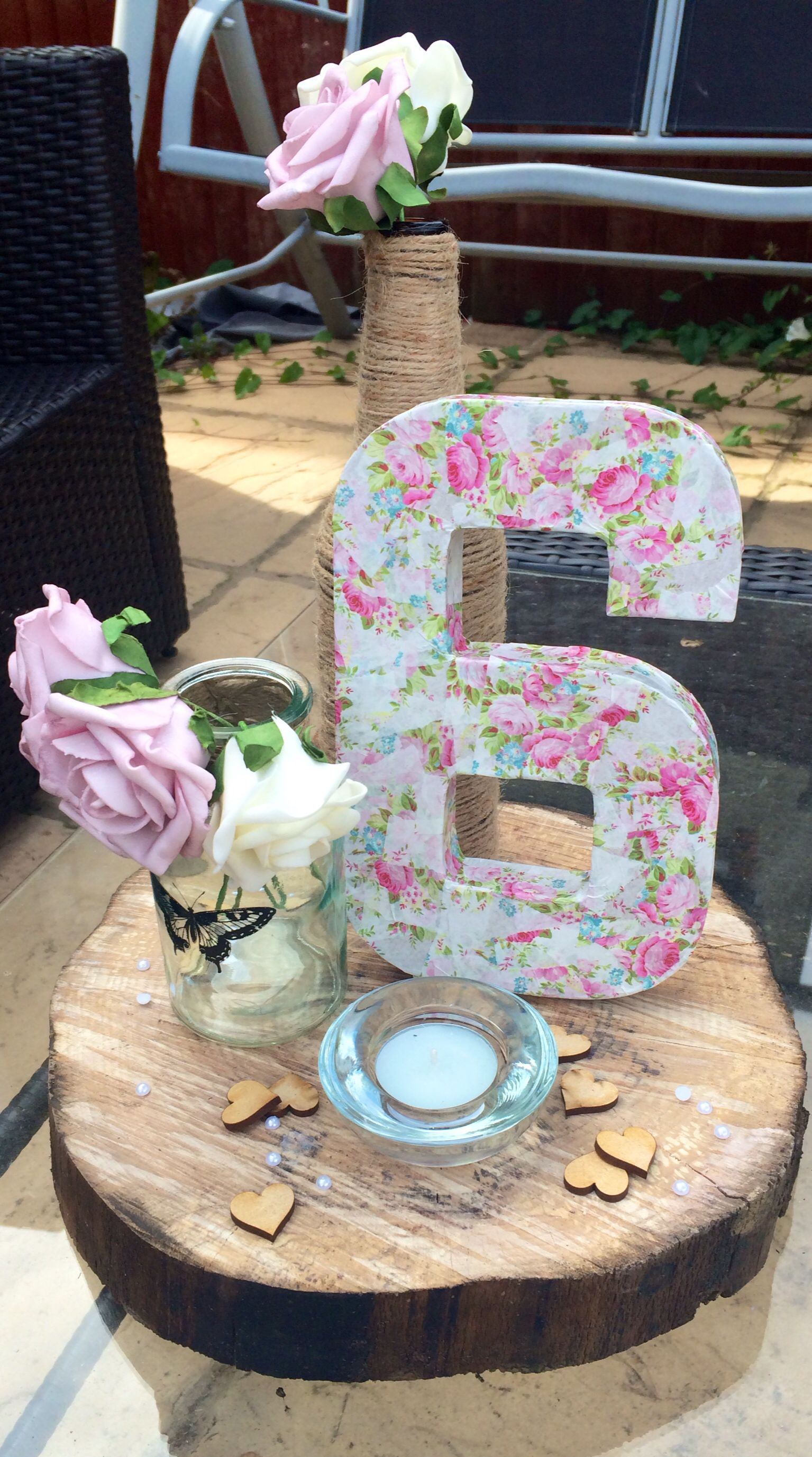 Table centrepieces... Decopatch number, wooden log, scatter pearls, wooden heart, small butterfly jar, candle, twine bottle, flowers... X