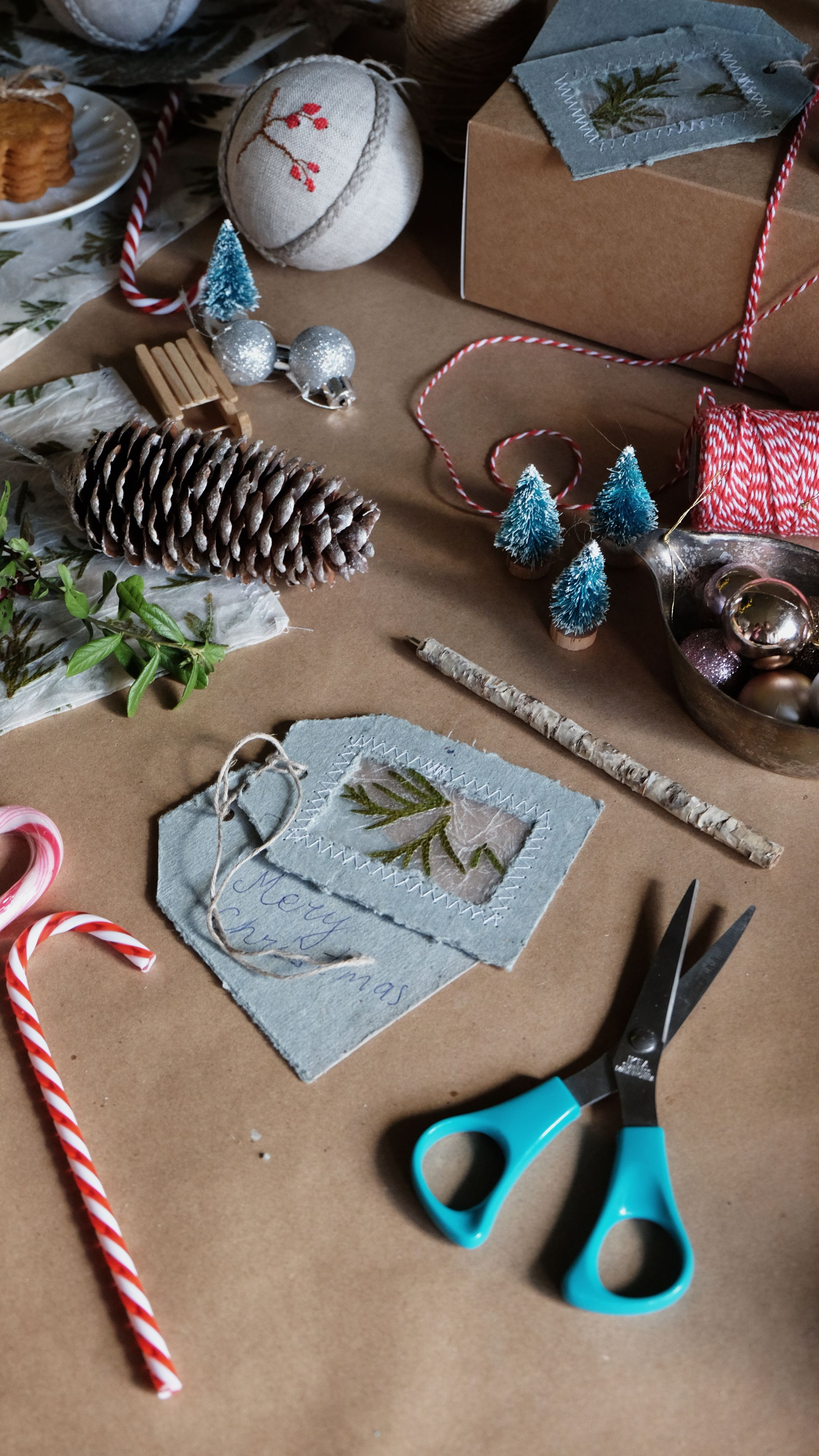 Gift tags from gray recycled paper with pressed plant t
