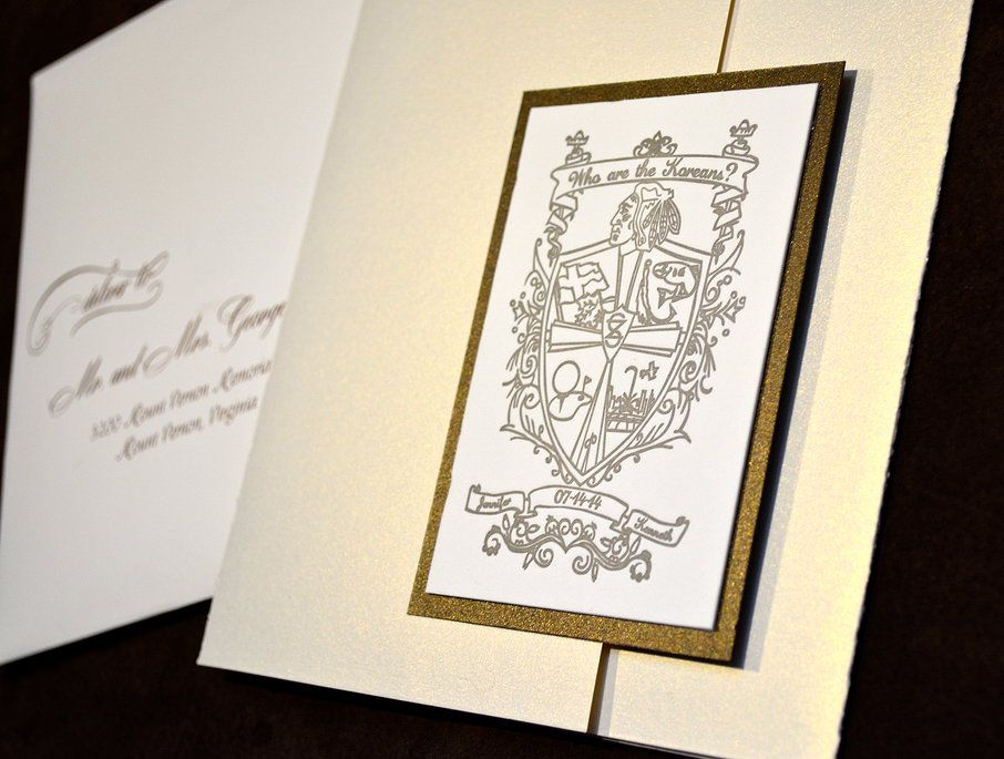 A custom designed crest is the focal point of this elegant destination wedding invitation by Lucky Invitations | Custom Letterpress Invitations | Chicago