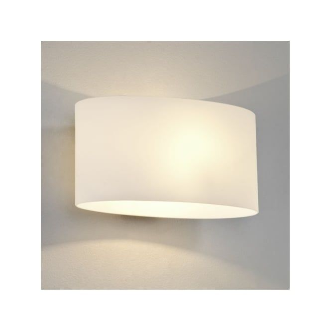 This wall light has a polished chrome finish and comes complete with a white glass shade