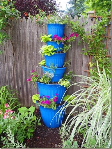 Stack Plastic Planters On Top Of One Another To Make A Beautiful