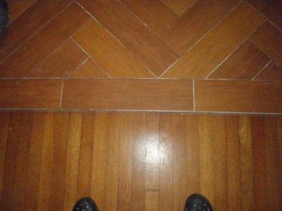 Transition Between Herringbone Plank Tile Floor And