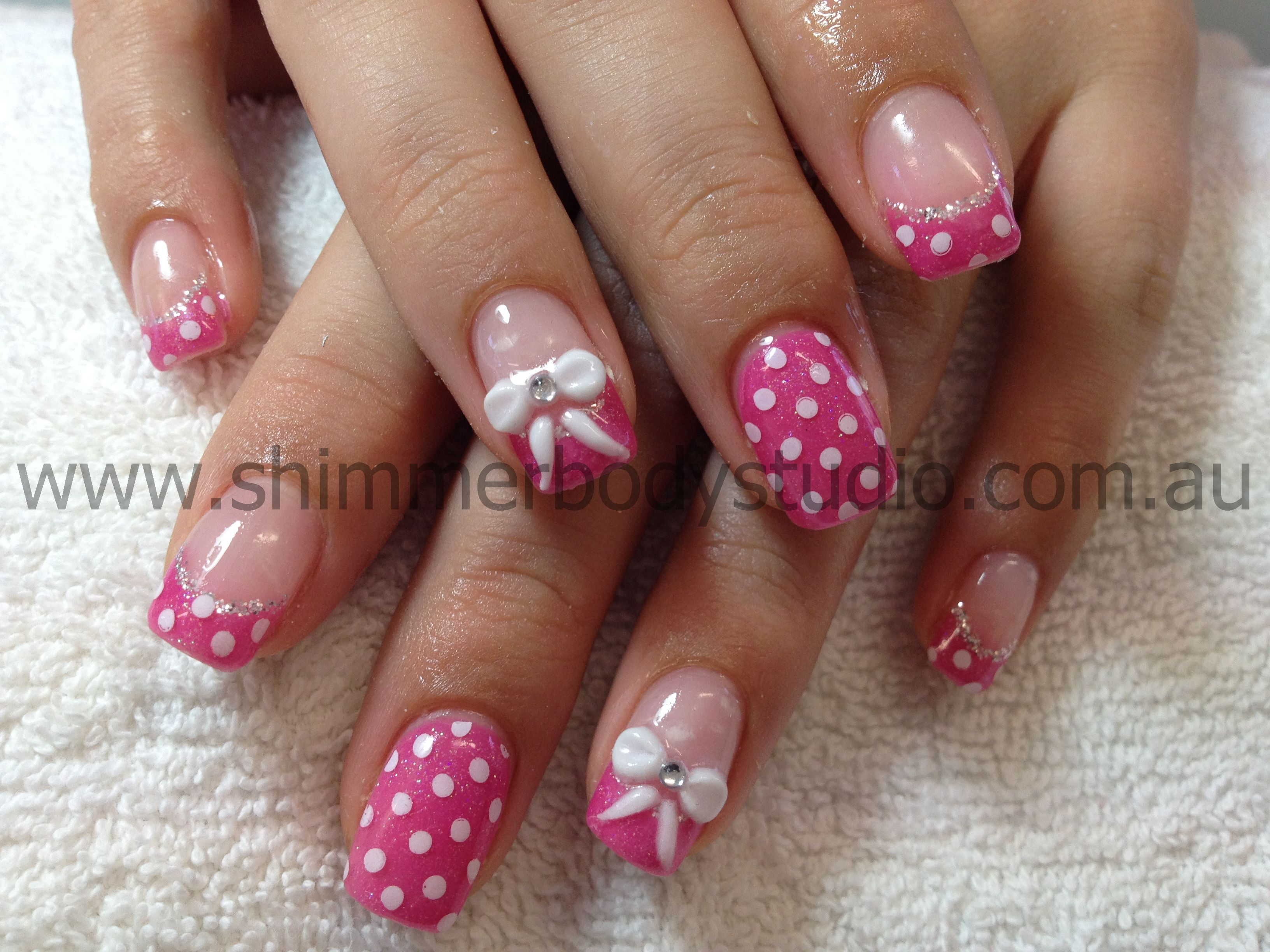 Gel nails, feature nail, pink nails, polkadot nails, bows nail art, 3d sculpted nail art by Shimmer Body Studio.