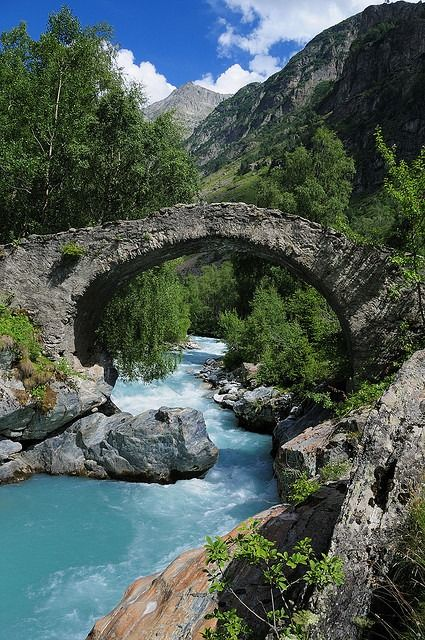 Roman bridge across Veneon River in Parc National des Ecrins, France by PascallacsaP