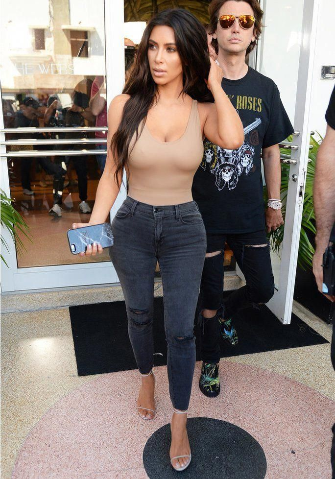 Kim Kardashian West Shows Off Her Post-Baby Figure in a Plunging Bodysuit #khloekardashian