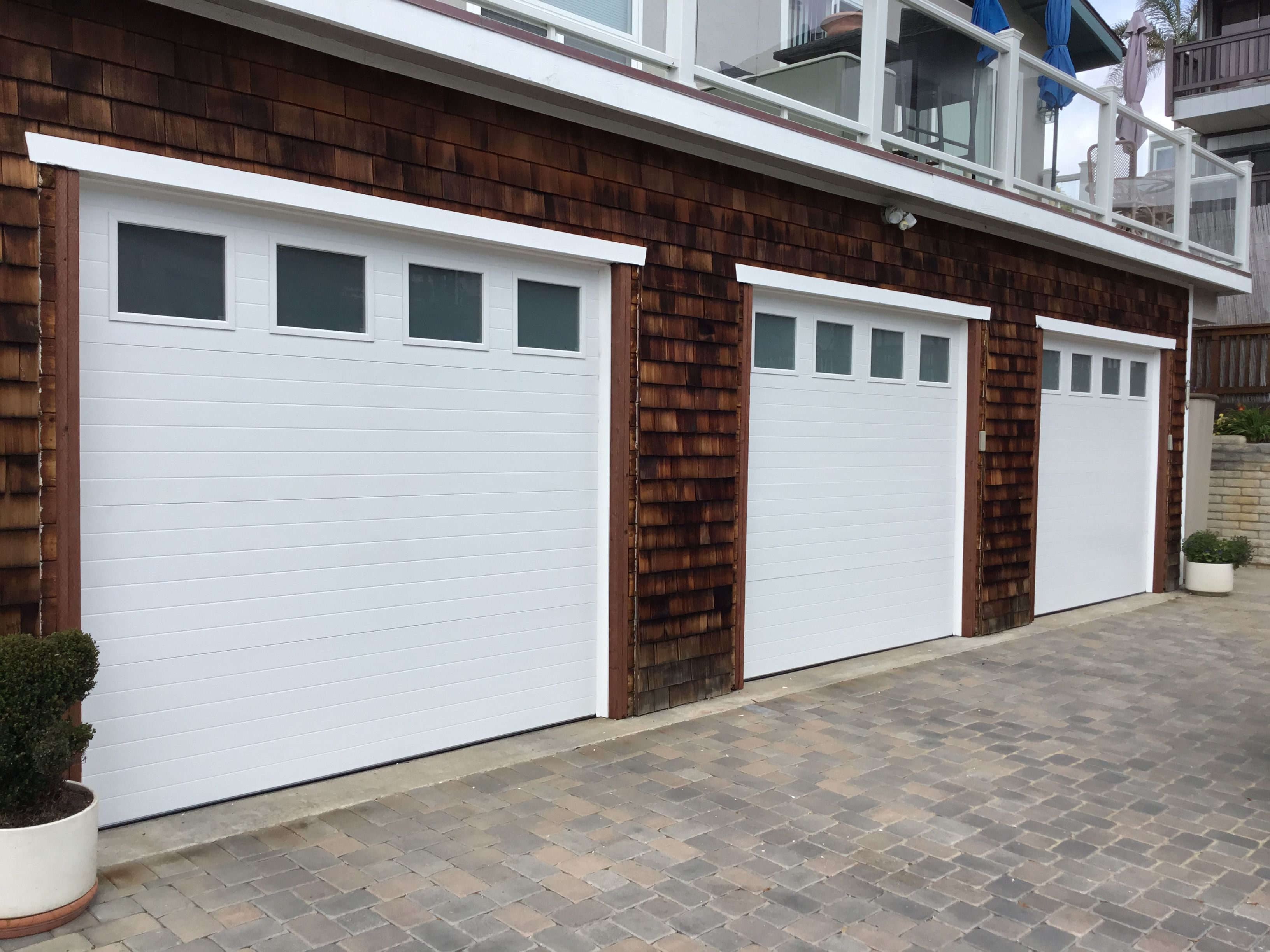 Clopay Modern Groove 3 Car Single Garage Doors With Frosted Glass