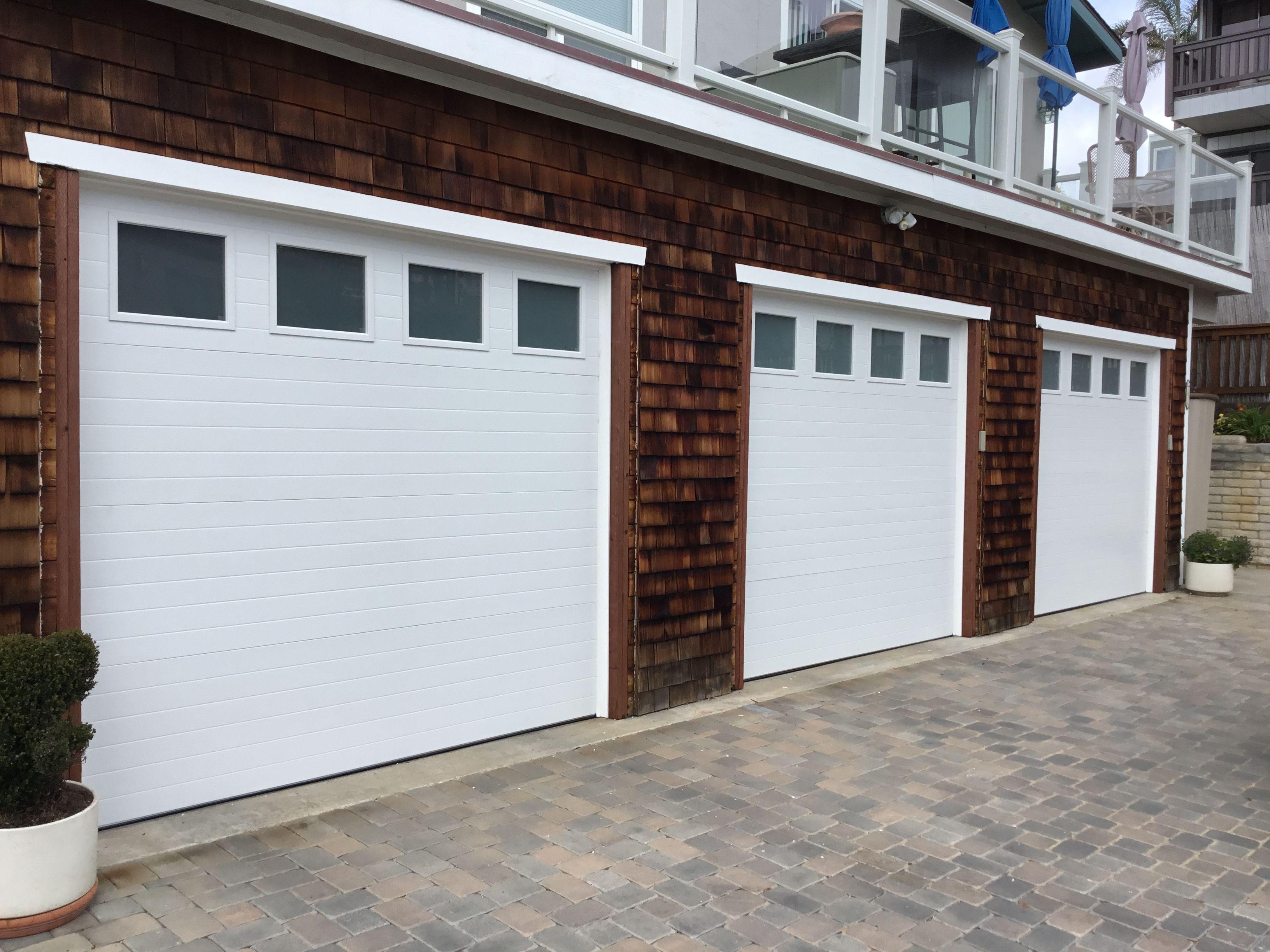Clopay Modern Groove 3 Car Single Garage Doors With Frosted Glass Looks Groovy Garage Door Styles Garage Door Types Garage