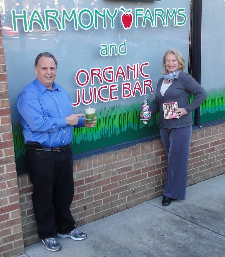 #BuyLocal  Showcasing Local Business and a sample of what they have available to buy for the Holidays: Harmony Farms Natural Food & Supplement Store have a number of great gifts. Nancy the co-owner is holding a box of Organic Candycanes (cornsyrup Free, Gluten free) and Seattle chocolates Truffles Variety and I am having one of the Tropical Green Organic Smoothie drinks made fresh in the store. #BuyLocal See their Facebook page:  https://www.facebook.com/HarmonyFarmsNC