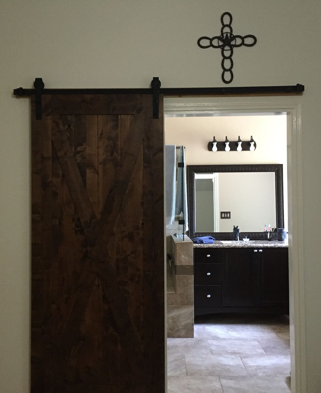 Our barn door. Ordered from Lowes and stained it myself ...