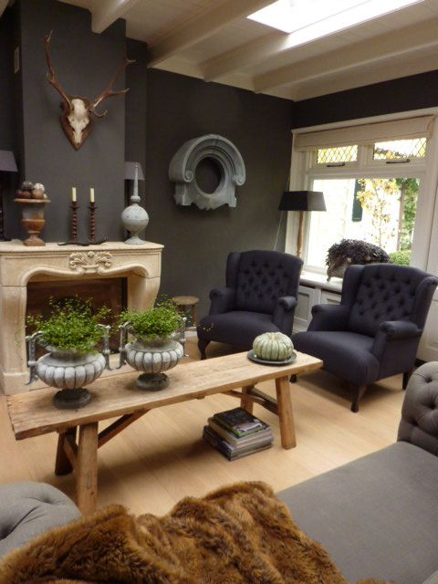 Living area with Great contrast between light coloured mantle and ...