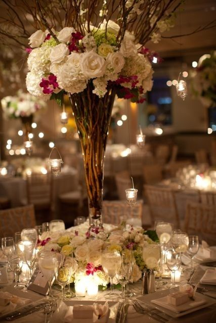 table decoration; white lights and white flowers