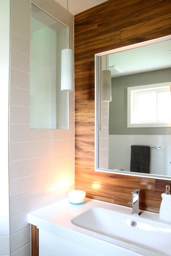 wood flooring on wall/bathroom remodel/white tile/pendant lights
