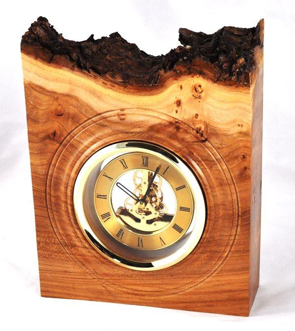 "Burr elm clock with natural edge bark retained. 5"" gold skeleton clock insert (quartz movement)."