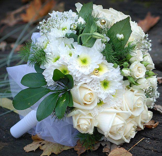 White rose, chrysanthemum, lisianthus, and baby's breath bridal bouquet with gold bead and green foliage .#origin_photos #nycwedding #lomgislandwedding #nycweddingphotographer