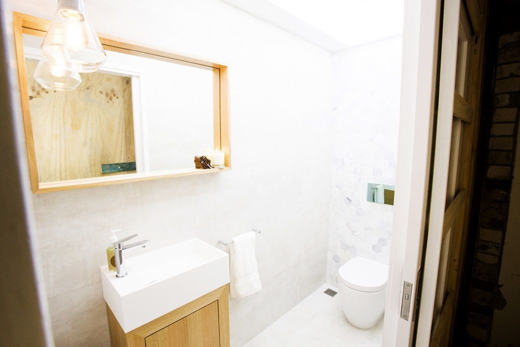 This Simple And Elegant Powder Room Features The Icon Bone