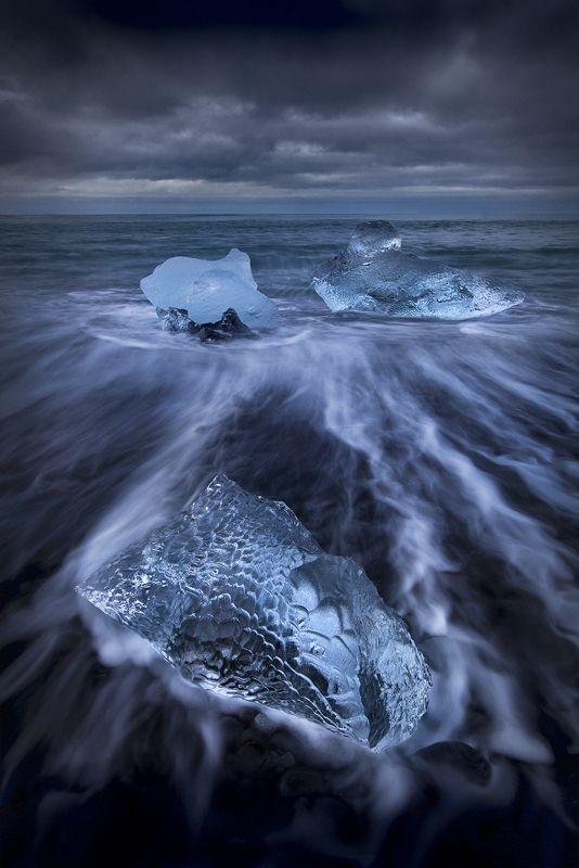 Glacier ice on the black volcanic sand beach at Jokulsarlon in Iceland