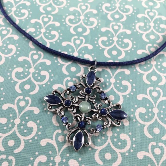 "Antique Style Filigree Pendant Necklace Pretty distressed antique style pendant with faux stones on a nylon string. The pendant is almost 2"" tall and the necklace is 16"" long. Bundle and save even more! :) Jewelry Necklaces"